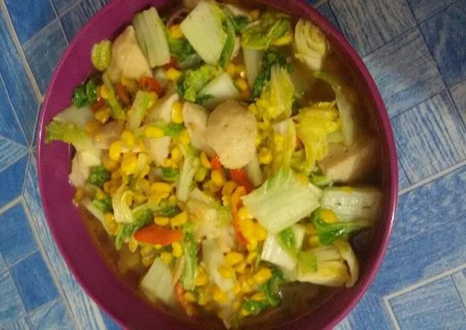 Tumis sawi dengan bakso cumi & jagung manis