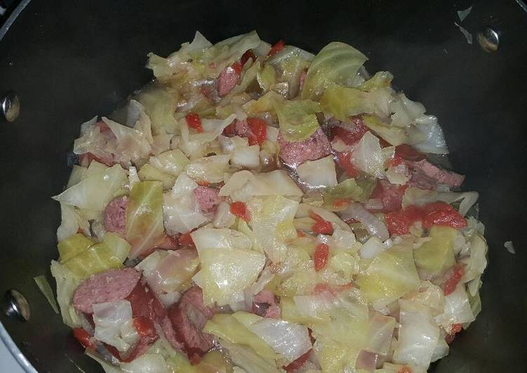 Boiled cabbage and beef sausage