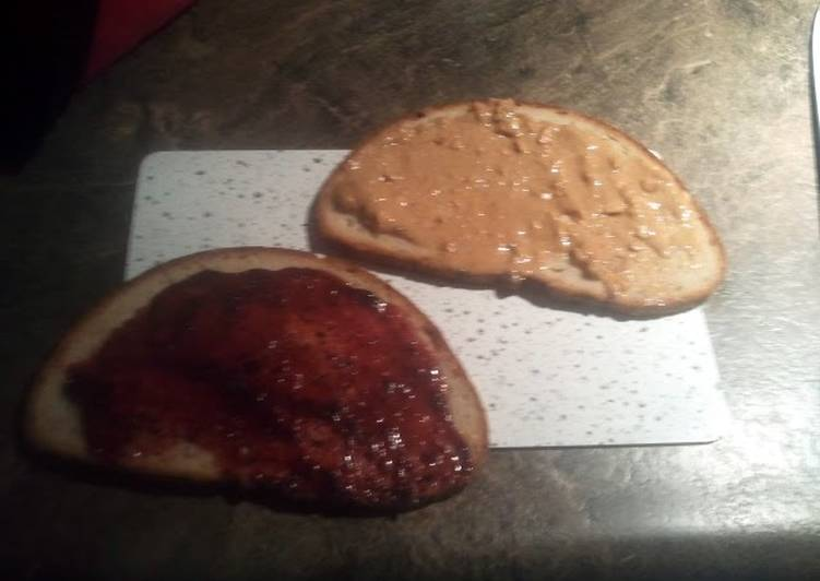 Steps to Make Favorite peanut butter and jelly on sunflower seed bread