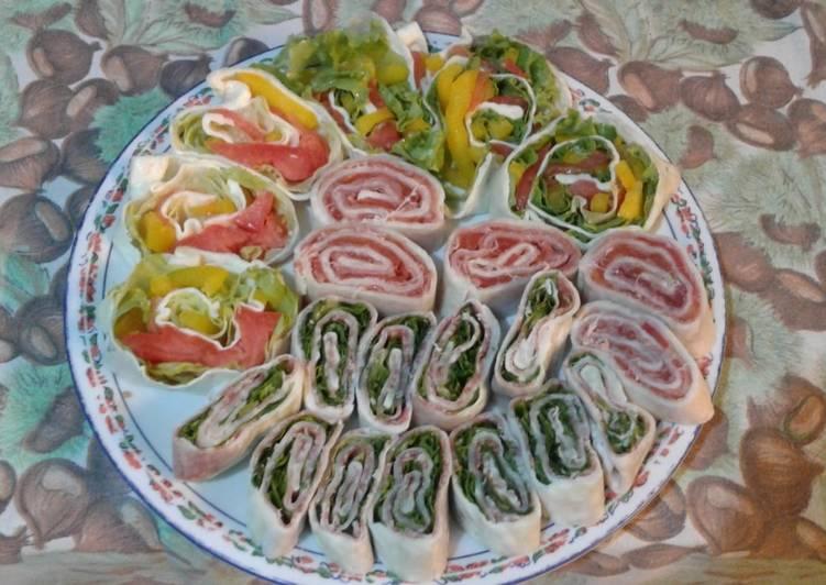 Ricetta Rotolini di mozzarella fantasia