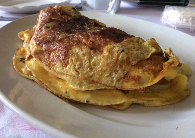 Omelette aux pommes de terre nouvelles et tomates confites