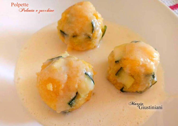 Polenta and zucchini meatballs on Parmigiano Reggiano sauce