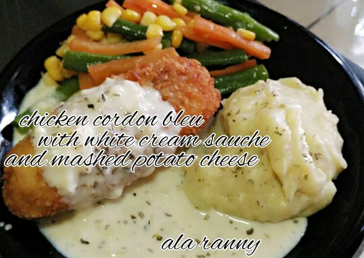 Chicken cordon bleu with mushed potato cheese and white cream sauce