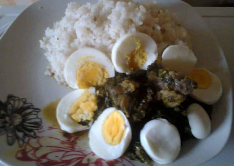 Ofada rice,Vegetable stew,beef and Boiled Eggs