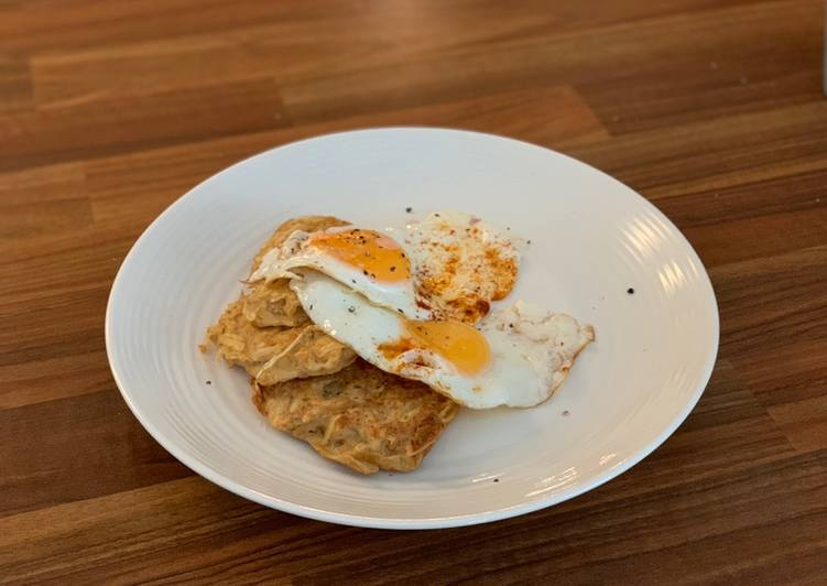 Potato hash browns with fried eggs