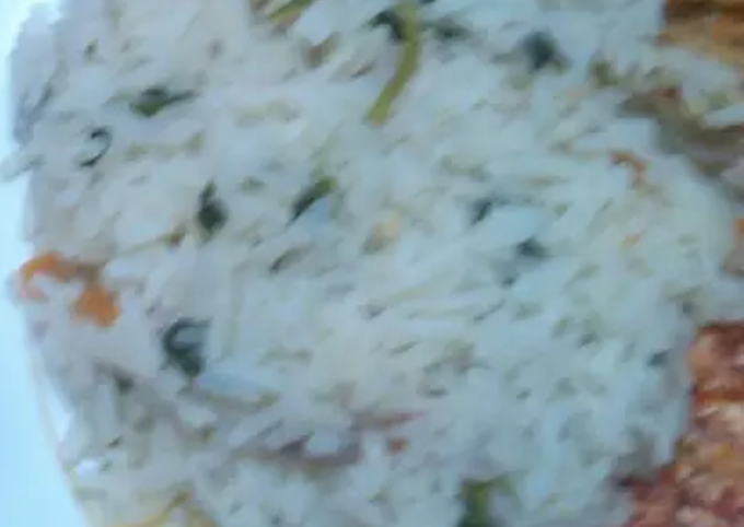 Vegetable rice, Fried Eggs and fried Cabbage and Mango juice