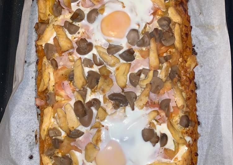 Pizza integral con pollo y más cosas