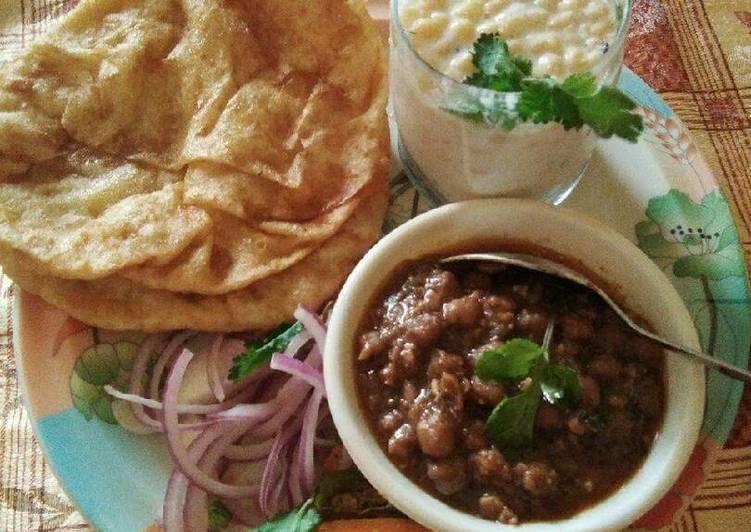 Panjabi chole bhature onion and Bundi ka Raita