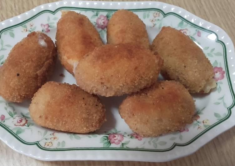 Croquetas de jamón dulce, y queso manchego