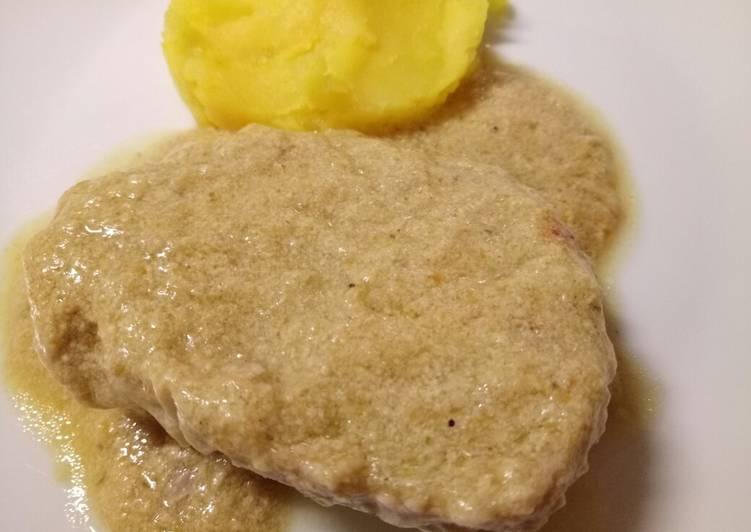 Pork in a creamy artichoke sauce with saffron mash