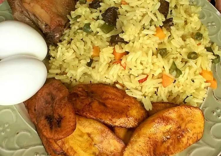Fried rice with fried plantain,boiled egg and chicken