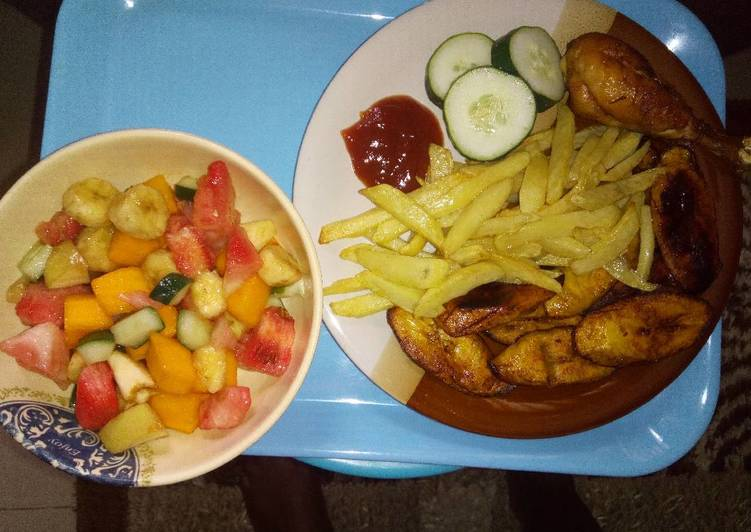 Chips, plantain with chicken N' Fruit salad!
