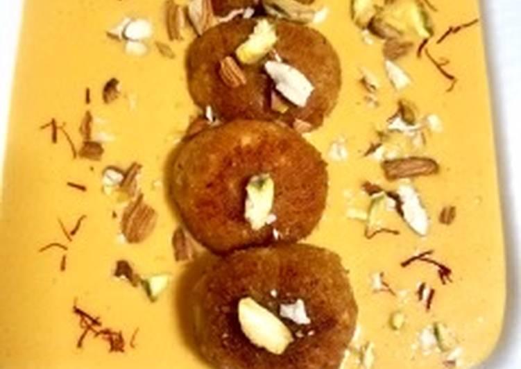 Paneer balls in Alphonso mango Rabdi
