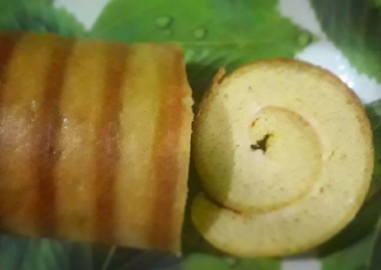cara menyajikan Roll cake almond kelapa - Sajian Dapur Bunda