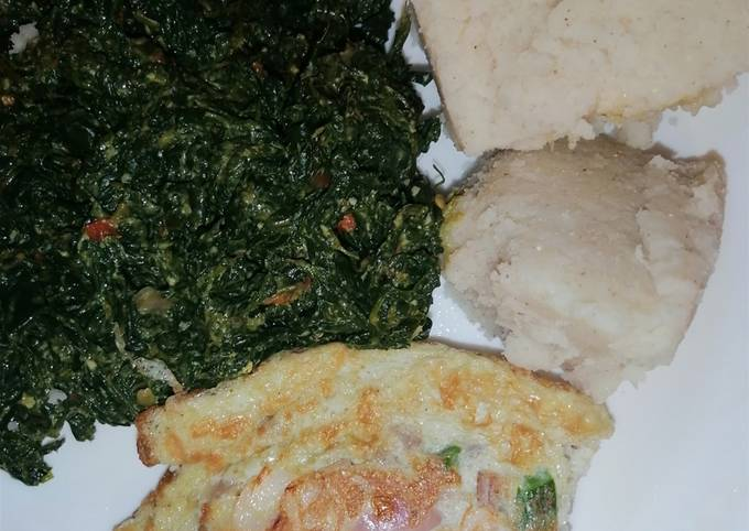 Ugali, kunde cooked in cream with scrambled vegetable eggs