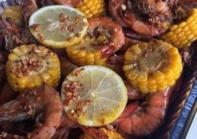 Spicy lemon butter garlic shrimp with corn