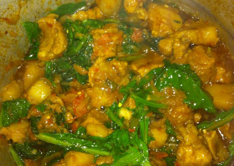 Pork with rai saag(mustard leaves)