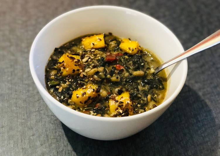 White Bean and Swiss Chard Egusi Soup with seed coated Polenta bites
