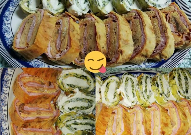 Ricetta Rotolo di frittata con spinaci e ricotta e ragù prosciutto cotto