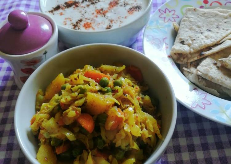 Recipe: Appetizing Cabbage dry curry and raita