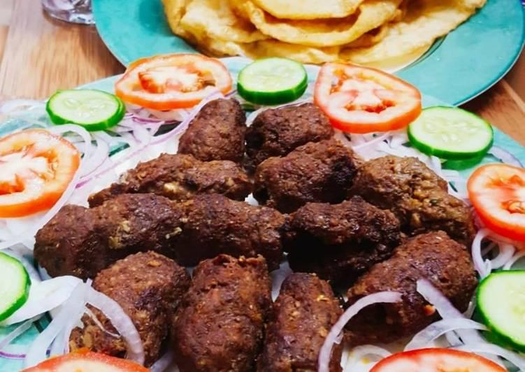 Beef gola kabab with puri paratha,salad chutney