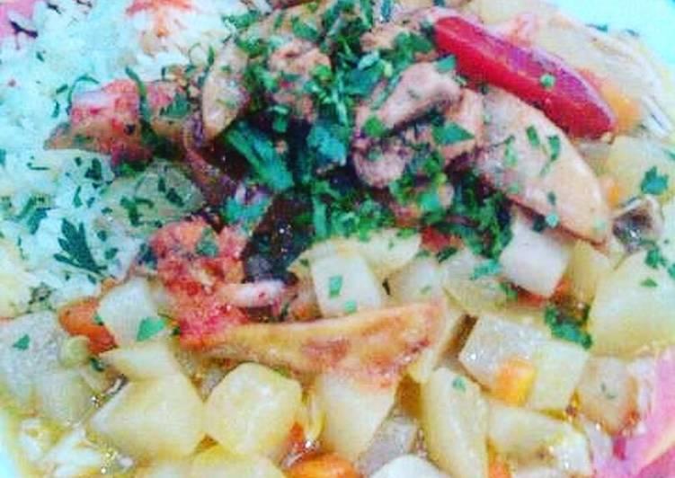 Combinado arroz con Cau cau, lomo y tallarines