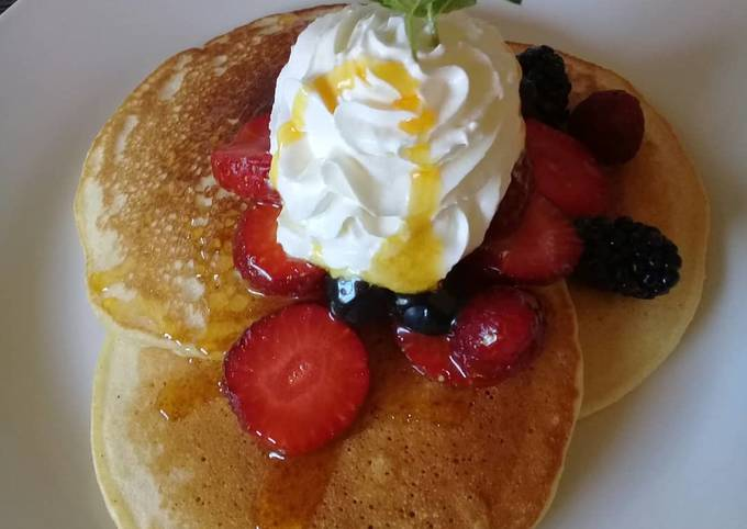 Pancakes with whipped cream and berries