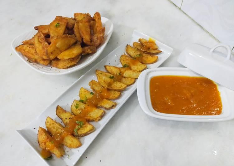 Steps to Make Homemade Crispy potato wedges with spicy mango sauce