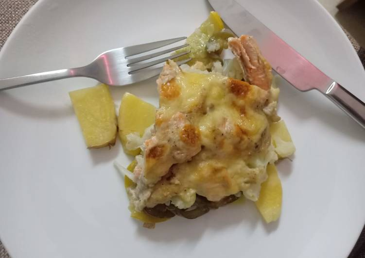 Potato bake with mushroom sauce and salmon