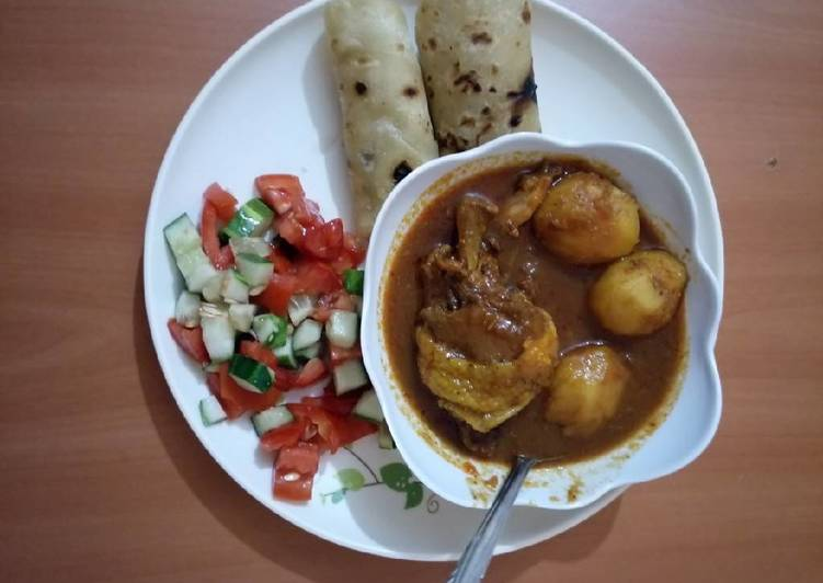 Recipe of Ultimate Chicken potato stew with chapati and tomato cucumber salad