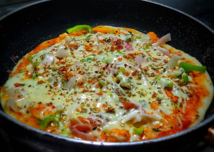 Veg delite pizza on tawa with homemade pizza base