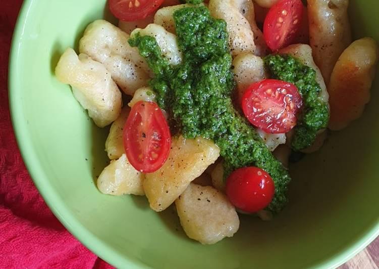 Homemade gnocchi with spinach pesto