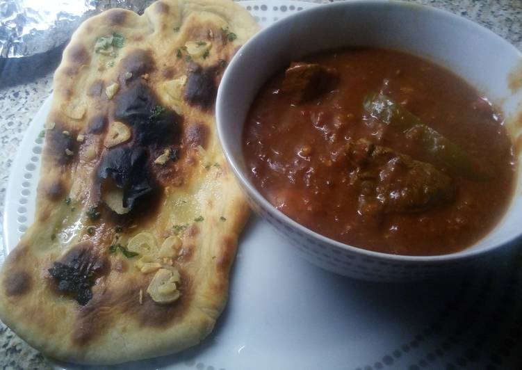 Beef Madras with garlic naan bread