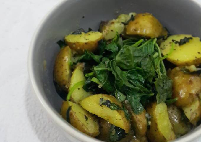 Sautéed baby potatoes with steamed spinach