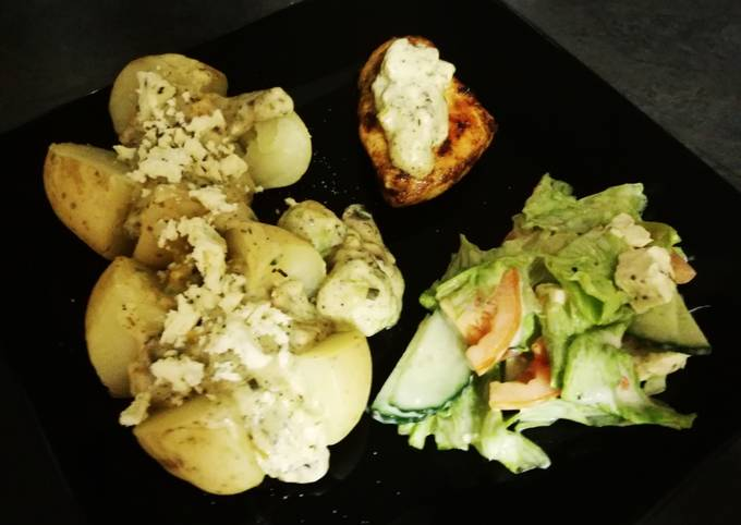 Baked potato and chicken breasts