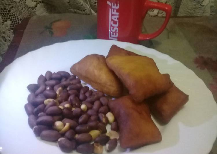 Easiest Way to Prepare Quick Roasted nuts, cardamom mandazi n a cup of hot black Nescafe