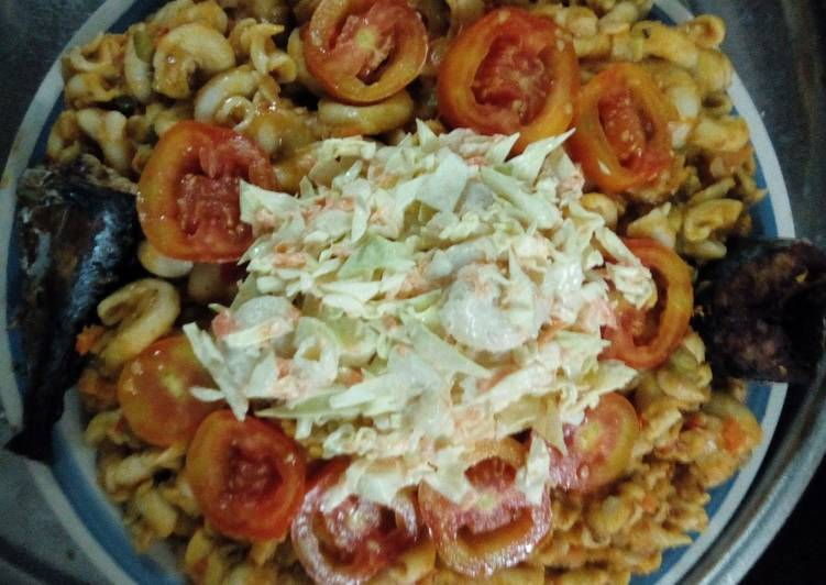 Macaroni,washed beans with salad, tomatoes and fish
