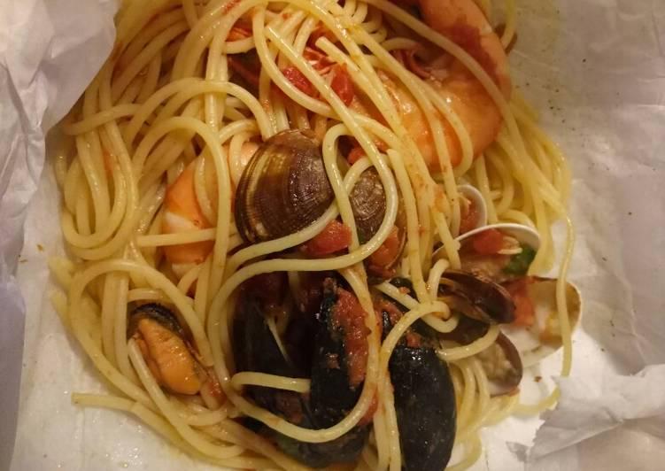 Spaghetti frutti di mare al cartoccio