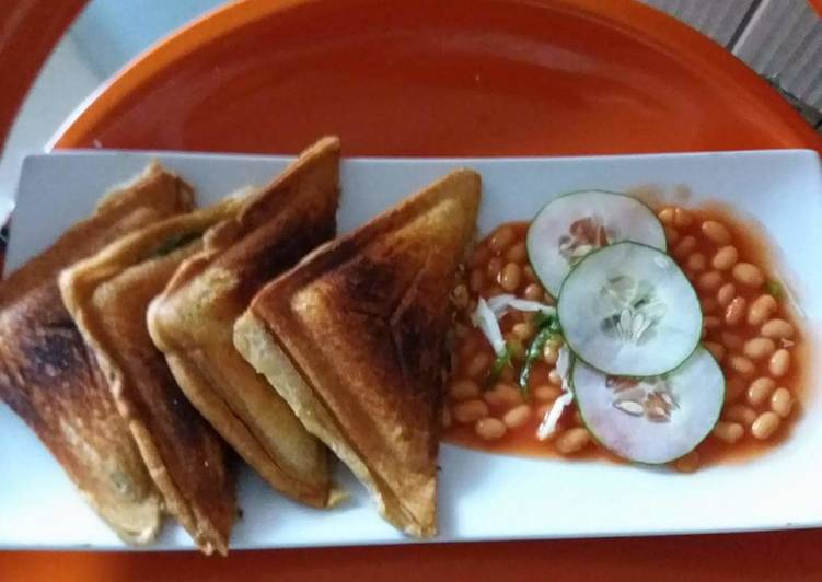 Simple Way to Make Ultimate Toast garnished with Baked beans and Cucumber