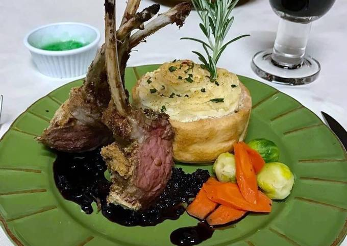 Rack of lamb with red wine sauce, garlic mashed potatoes, Brussels sprouts and carrots