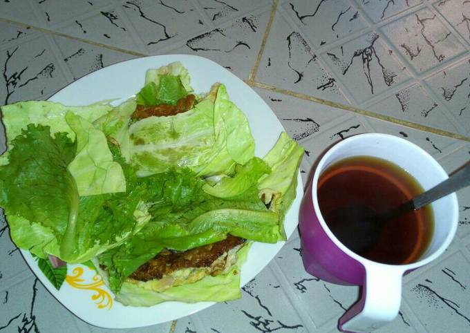 Fried Eggs wrapped in cabbage and lettuce with Tea