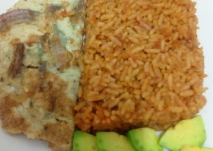 Jollof rice with fried egg and avacado