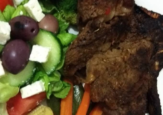 Shisanyama meat with healthy cooked vegetables