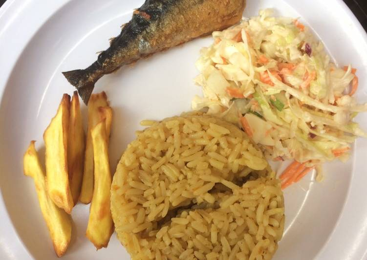 Jollof rice,salad with chips and fish