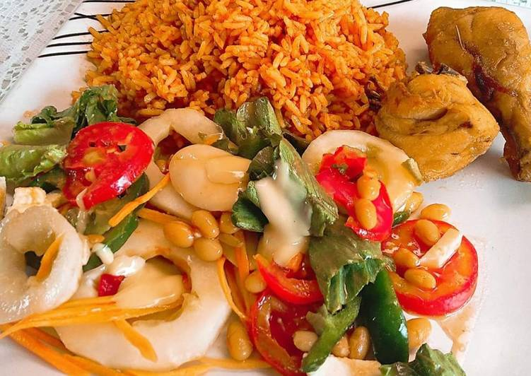 Jollof rice,fried chicken and salad