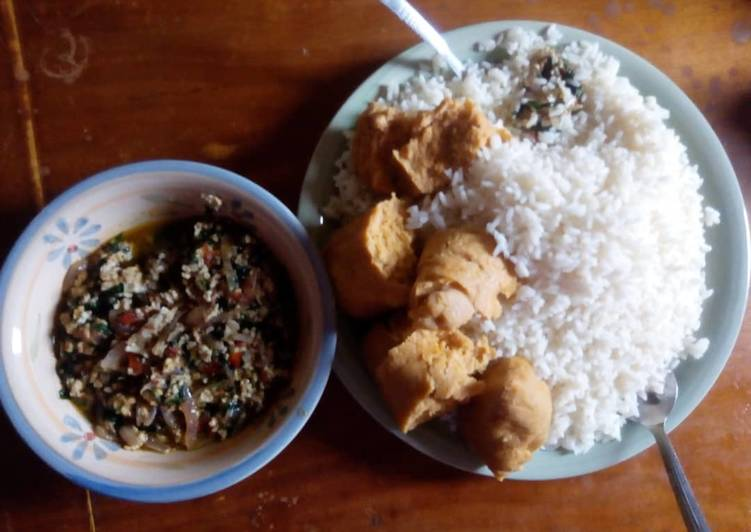African Dish Rice and moimoi with vegetable egg sauce