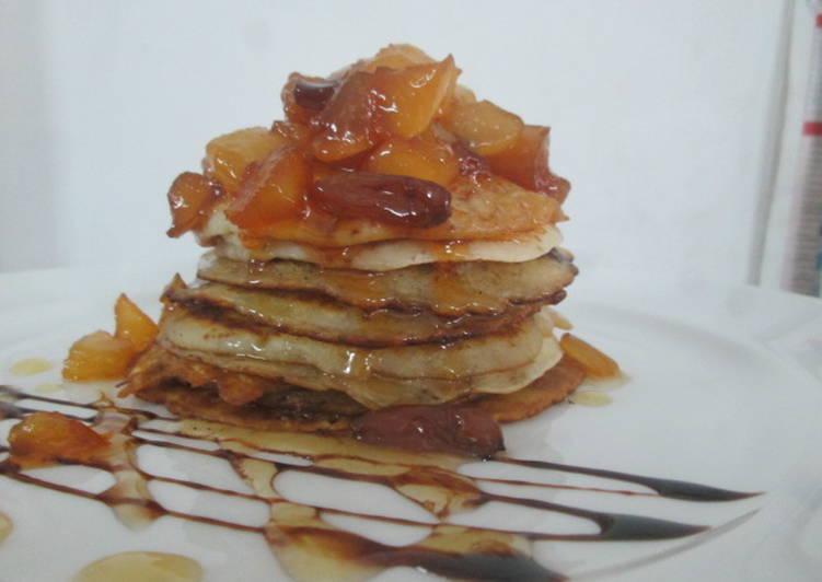 Wheat flour pancake with caramelized fruits and honey glaze