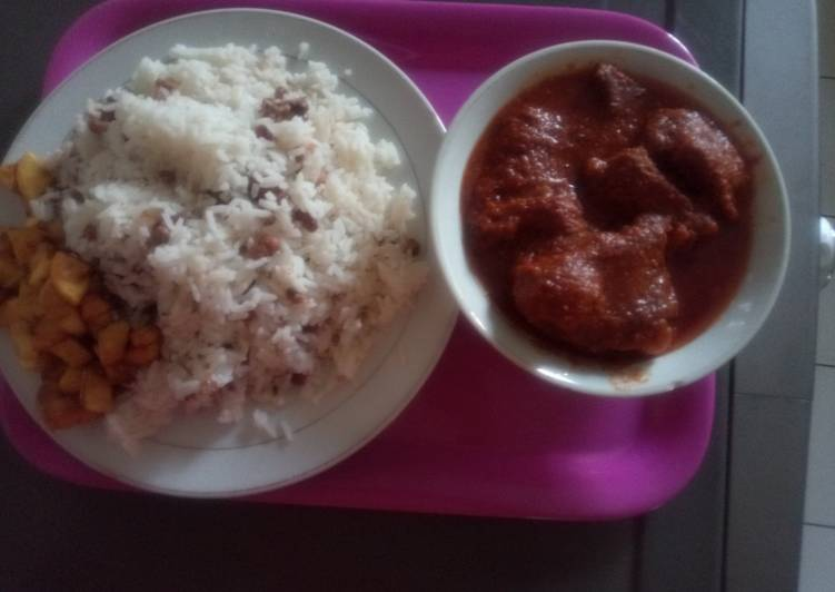 White Rice mixed with Beans and diced plantain with stew