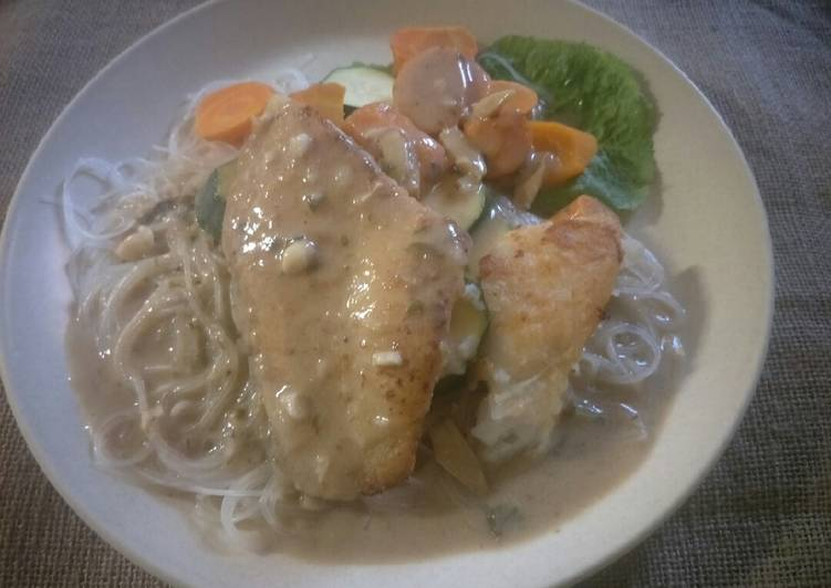 Pan fried fish fillet with green curry sauce