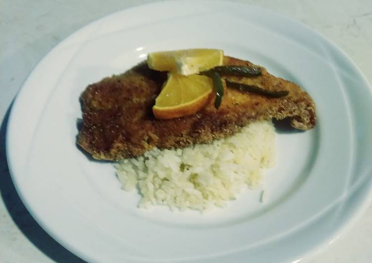 Fried cajun mangove snapper with citrus garlic butter rice